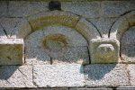 Arc et modillons: petite tête (sud)