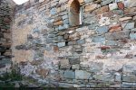 Mur nord: restes d'enduit. Tout le mur était recouvert de fresques
