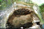 Arc triomphal en partie recouvert de stuc baroque