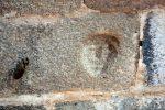 Petite tête en relief à l'intérieur du mur occidental