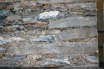 Traces d'outils sur les pierres de l'angle nord-ouest